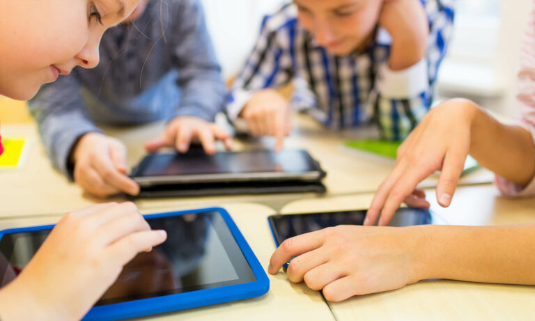children playing on tablet devices